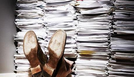 man_buried_under_papers.jpg