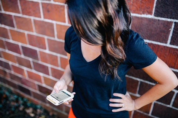 woman_on_brick_wall