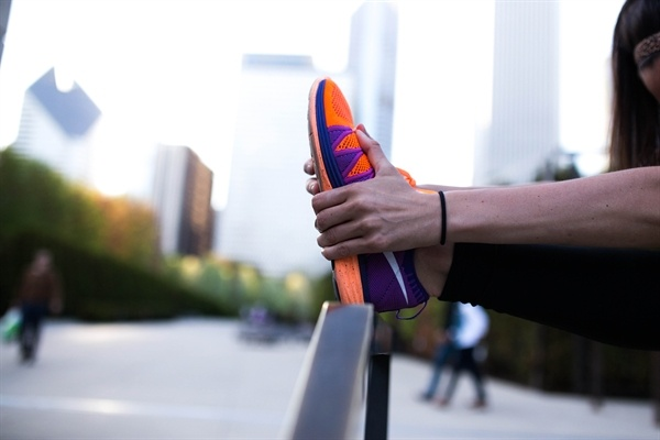 woman_stretching_bright_shoes